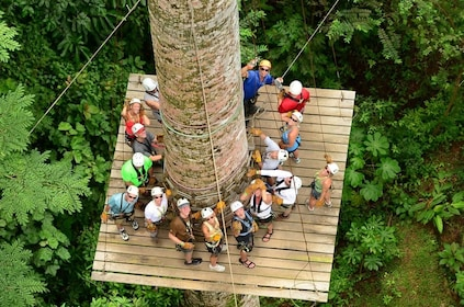 Aerial view of a group getting ready to zip line in Herradura