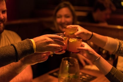 Group toasting cocktails at a bar in Melbourne