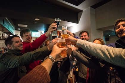 Tour group toasting with glasses of beer at a bar in Melbourne