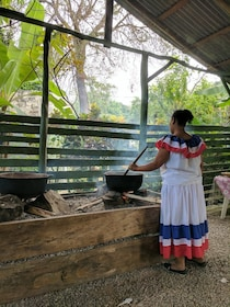 Woman stirring a pot over a fire in Punta Cana