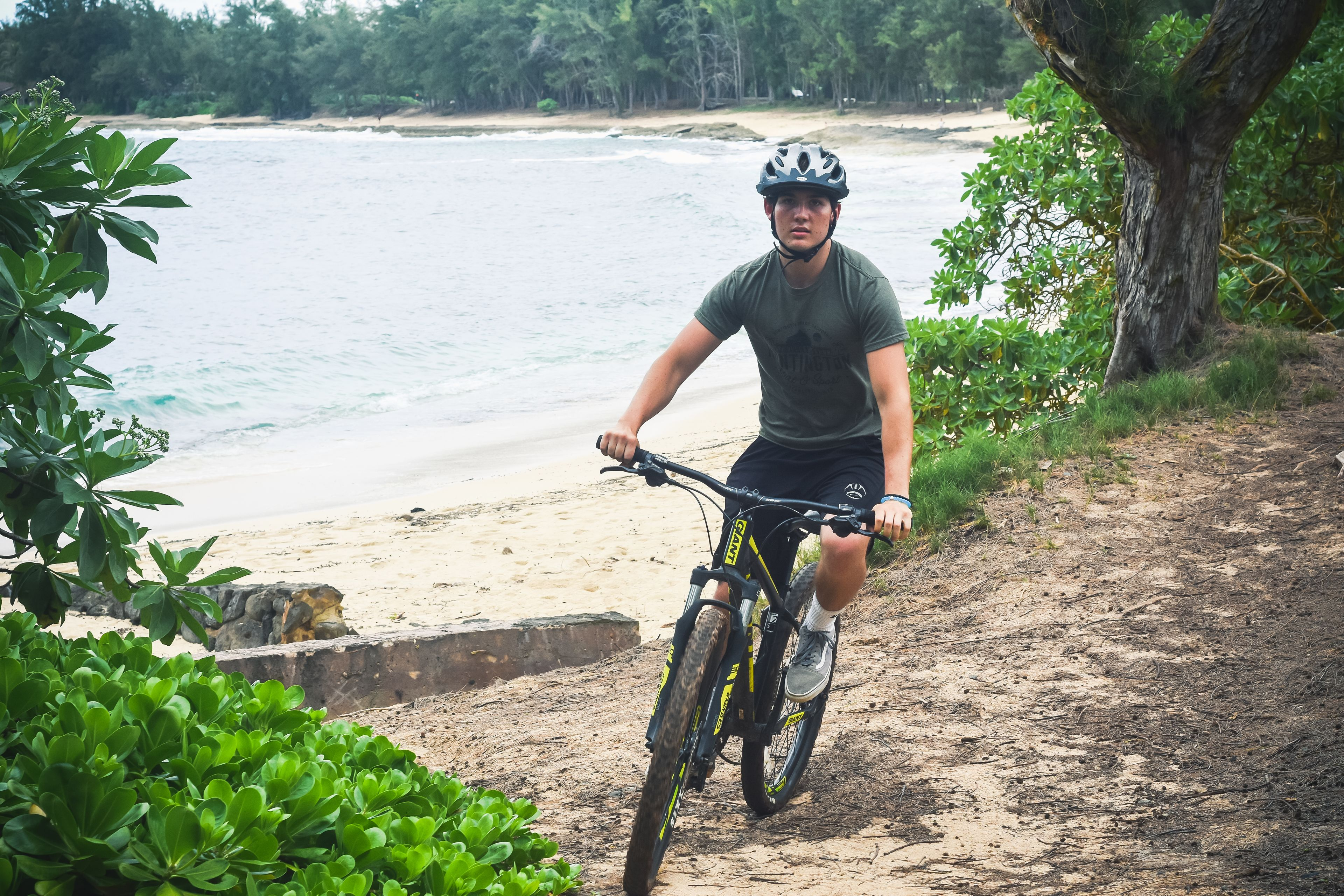 Man bicycling on the beach on Oahu
