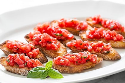 Dish of bruschetta with tomato and basil made on the cooking class with Chef Stefano in Taormina
