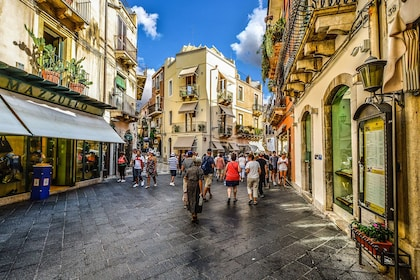 Group wandering the streets in Taormina, a comune in Sicily, Italy