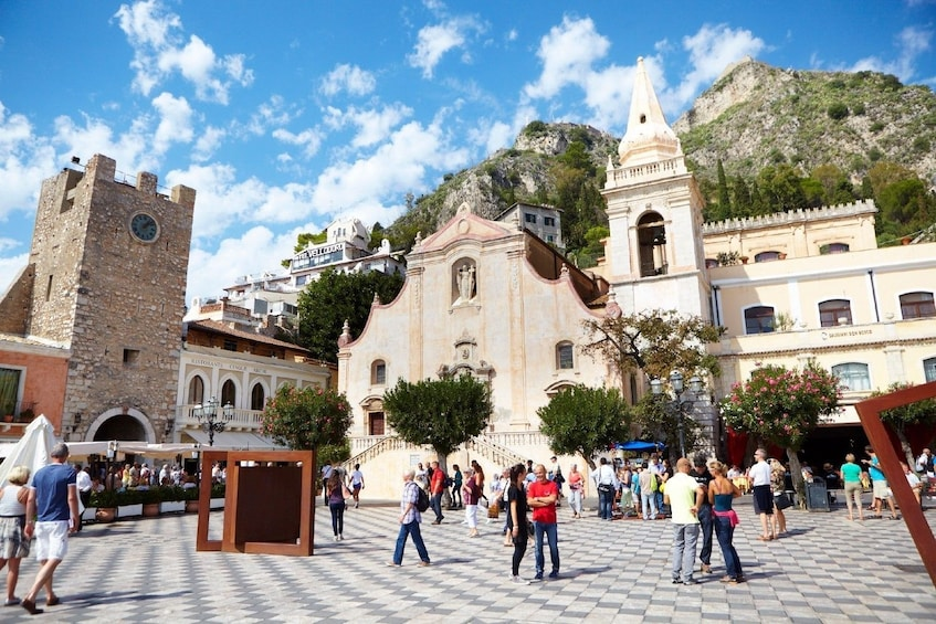 Show item 1 of 6. Guests exploring Taormina Comune in Sicily, Italy