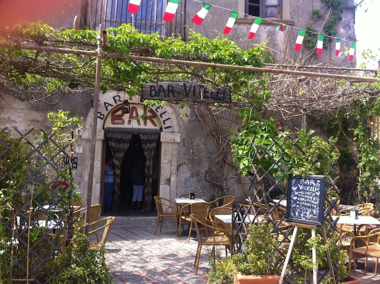 Show item 5 of 6. In front of Bar Vitelli in Italy