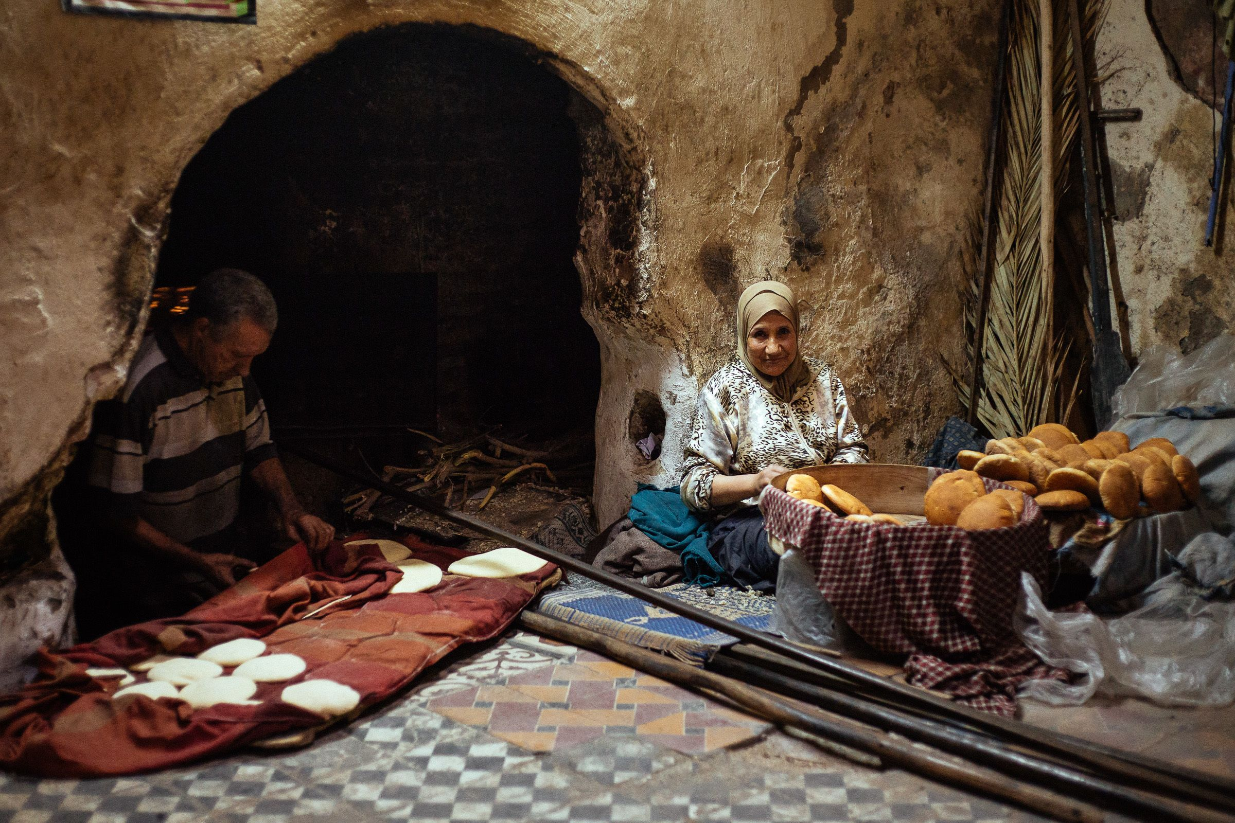 Two locals making bread in Marrakech