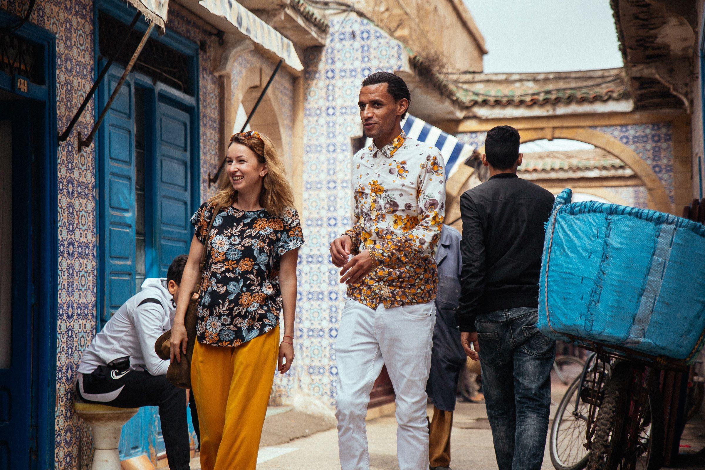 Couple walking an alley in Essaouira