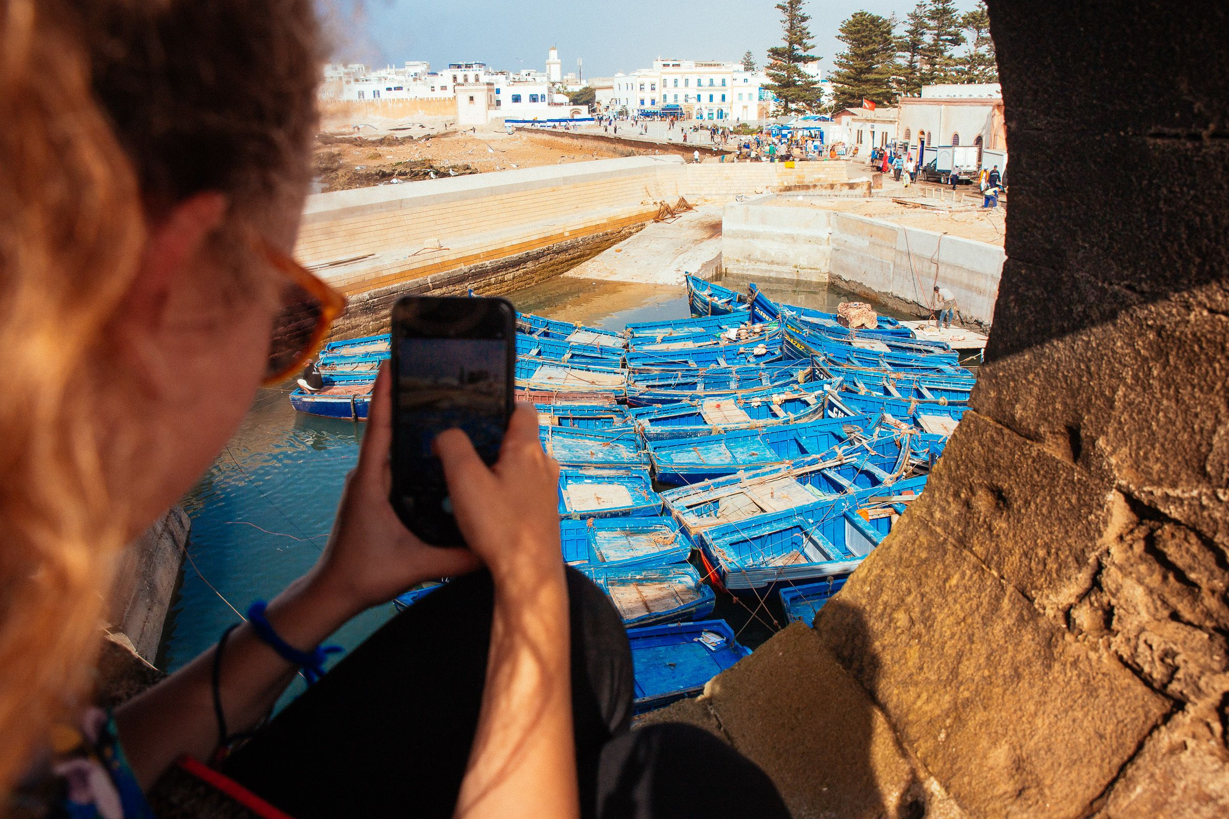 Person taking pictures of boats in Essaouira