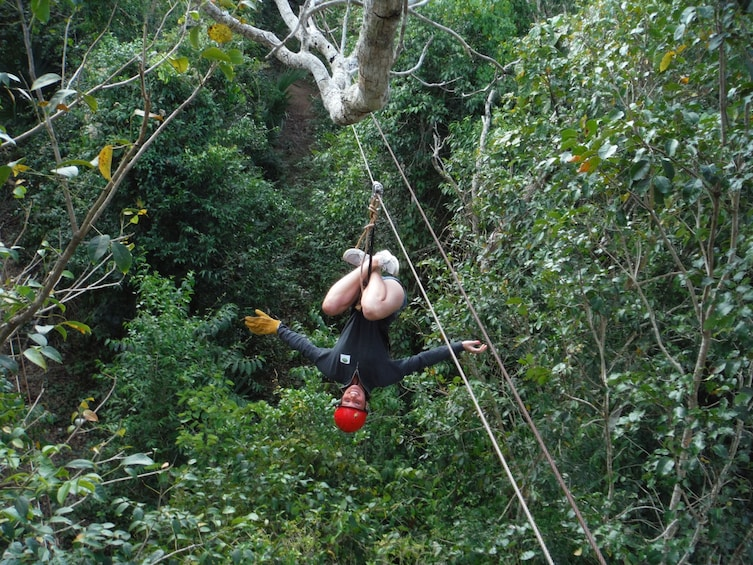 Ziplining man in Cancun