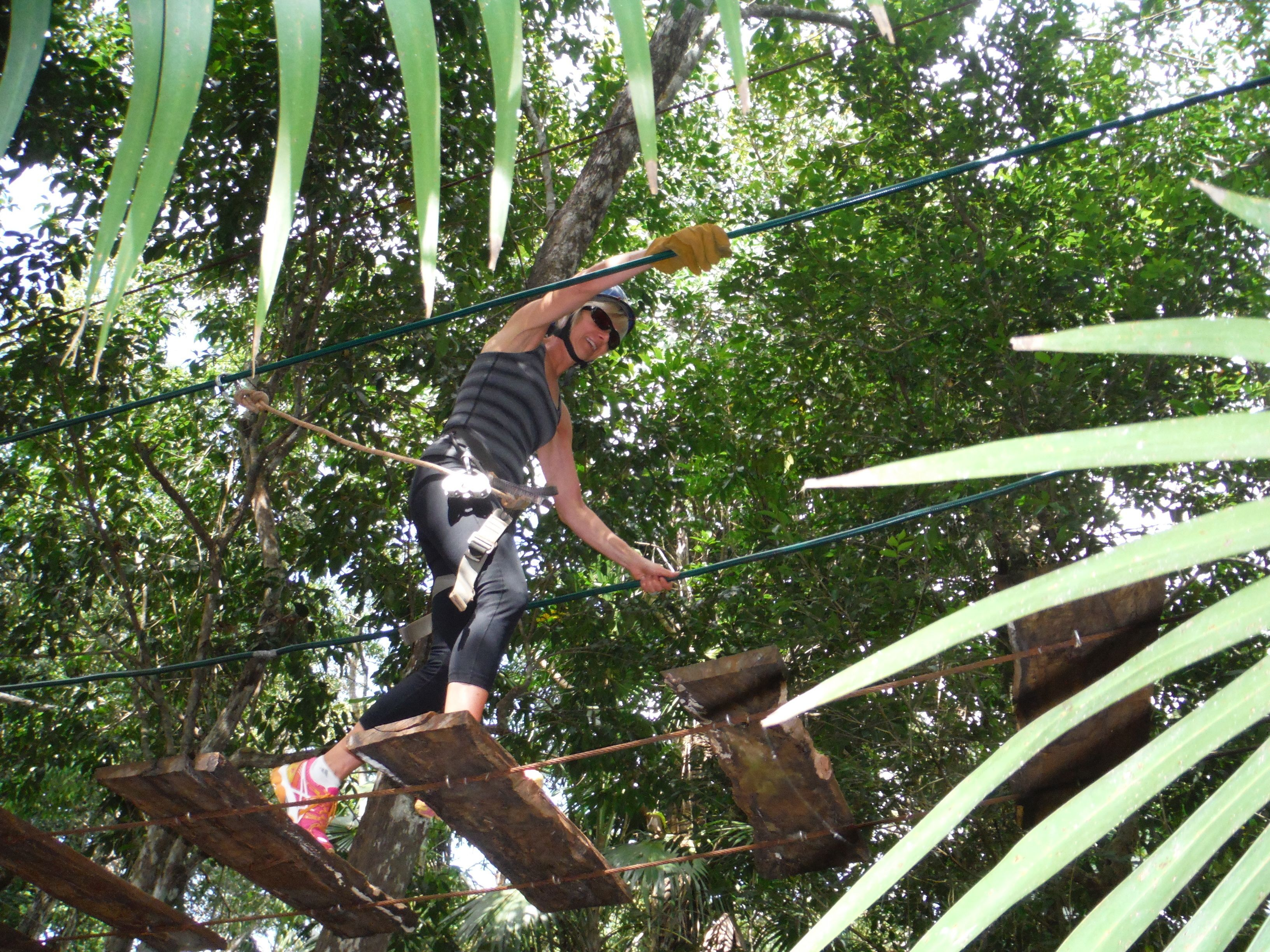 Woman on a tree ropes course in Cancun