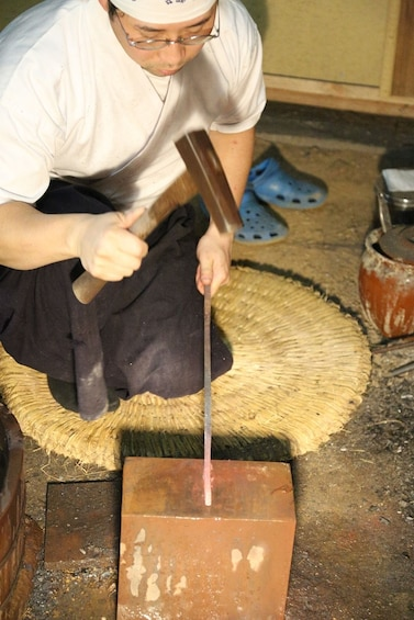 Show item 4 of 8. Man forging a knife in Japan