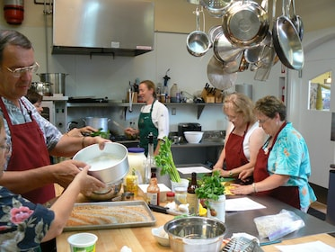 Cooking class working in a kitchen in Palermo