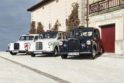 Three classic cars in Médoc