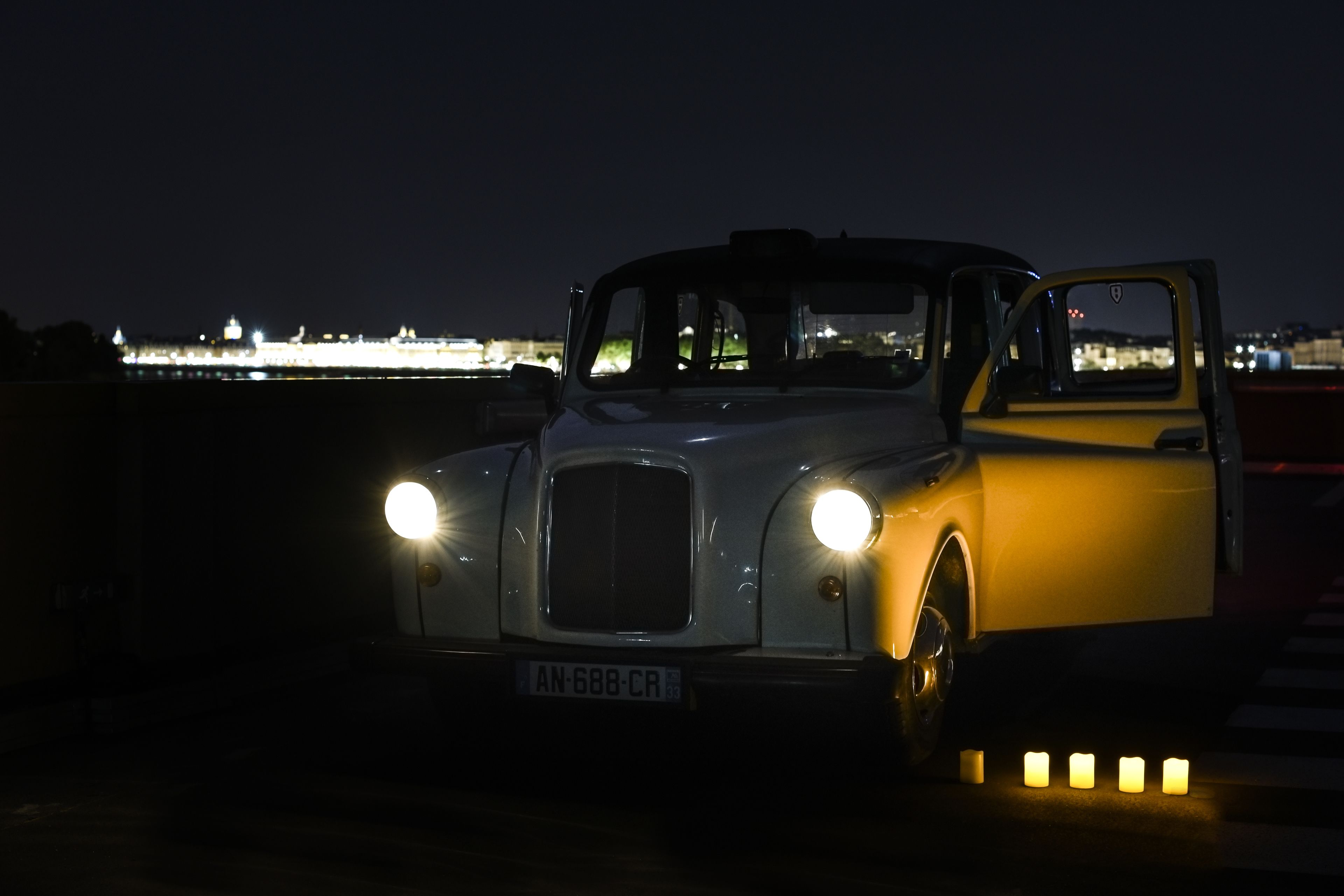 Bordeaux in an old fancy car at night
