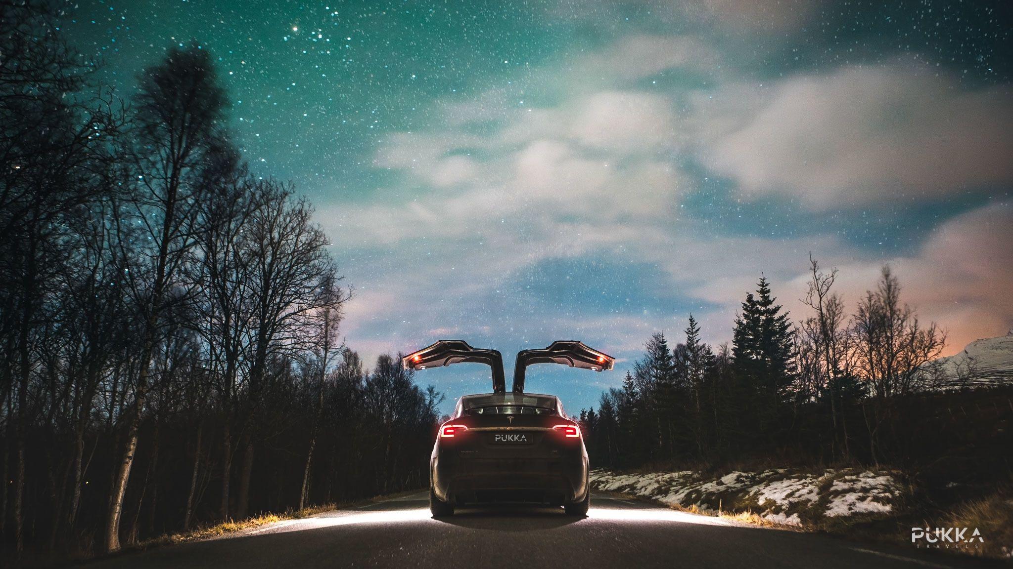 A Tesla vehicle at dusk
