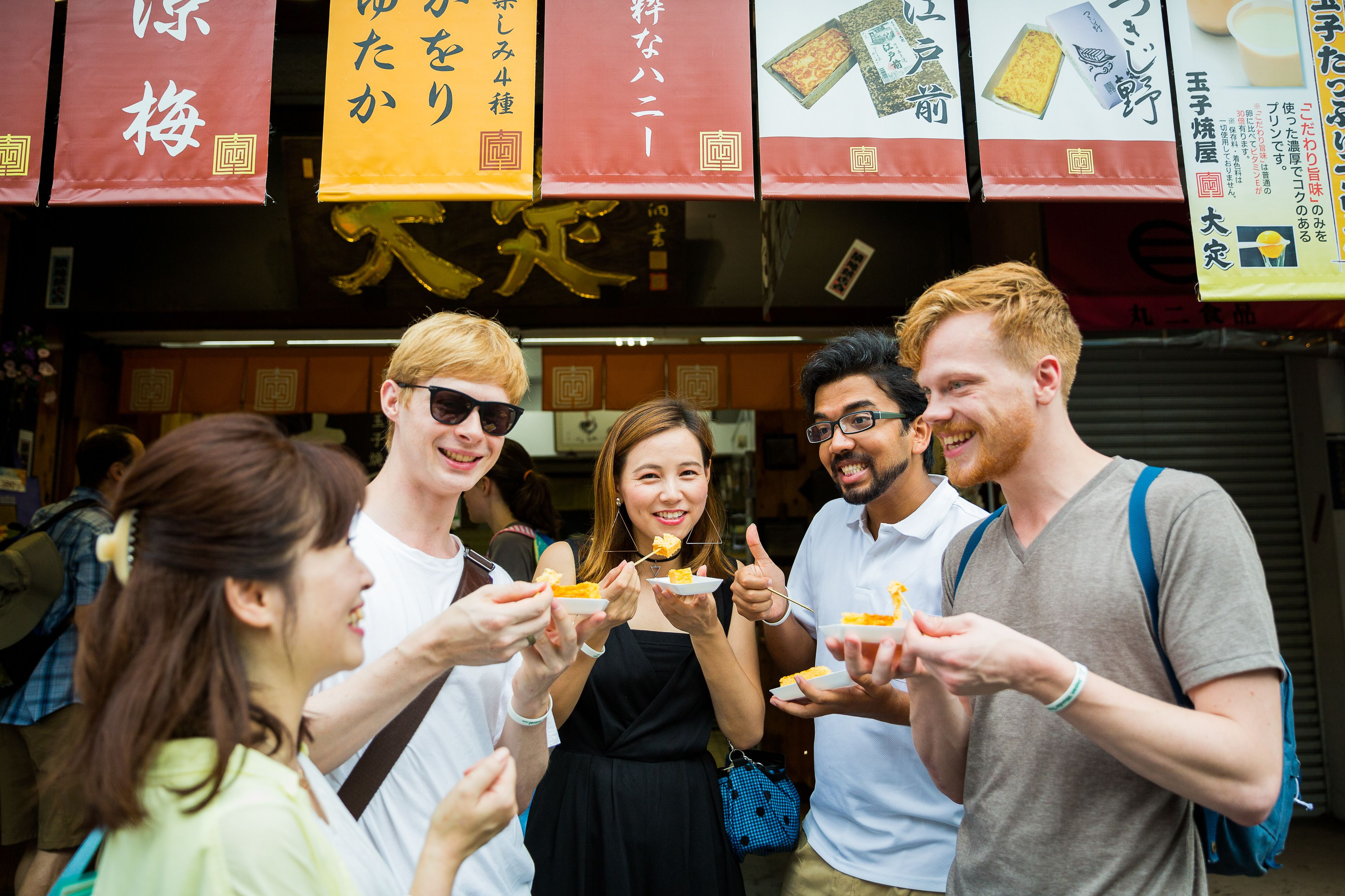 Group tasting delicious Japanese foods in Ch??, Japan
