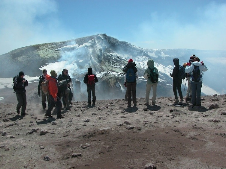 Hiking group stops to take in views of Mount Etna