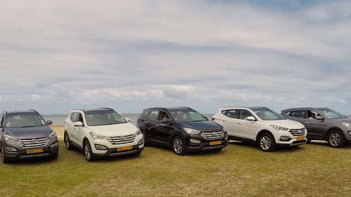 Row of SUVs parked near the coast in Mauritius