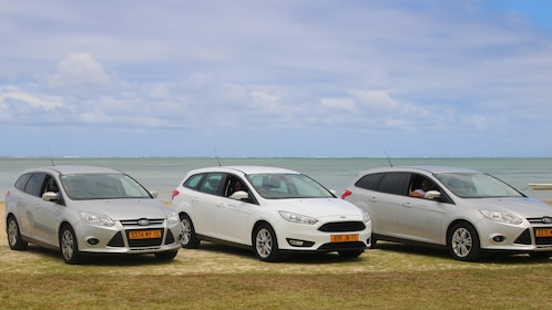 Row of cars parked near the coast in Mauritius