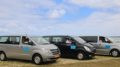Row of vans parked near the coast in Mauritius