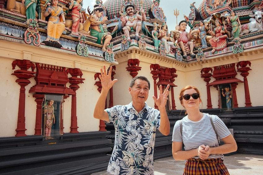Show item 4 of 6. Visitors at Sri Mariamman Temple, Singapore