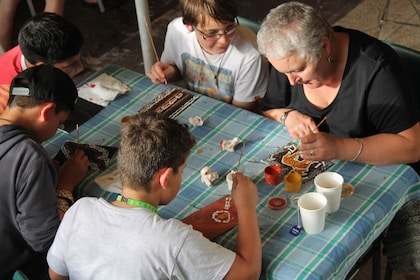 Group painting at the Janbal Aboriginal Art Gallery