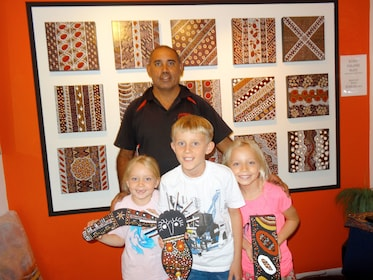 Family visiting the Janbal Aboriginal Art Gallery in Mossman