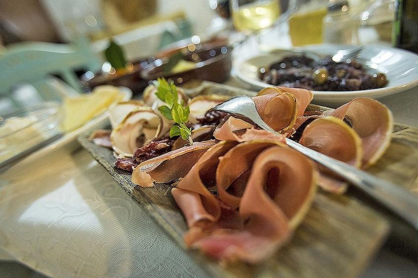 Show item 4 of 7. Charcuterie board at a restaurant in Cagliari