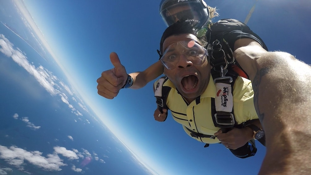 Show item 6 of 6. Man excited on the tandem skydive over Bells Beach, Torquay
