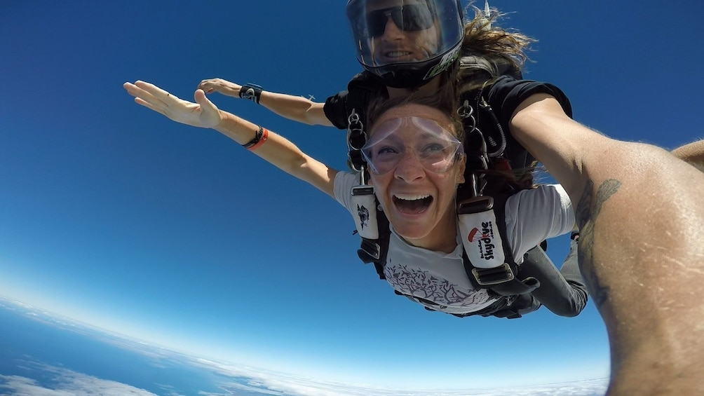 Show item 1 of 6. Couple full of excitement on the tandem skydive over Bells Beach, Torquay