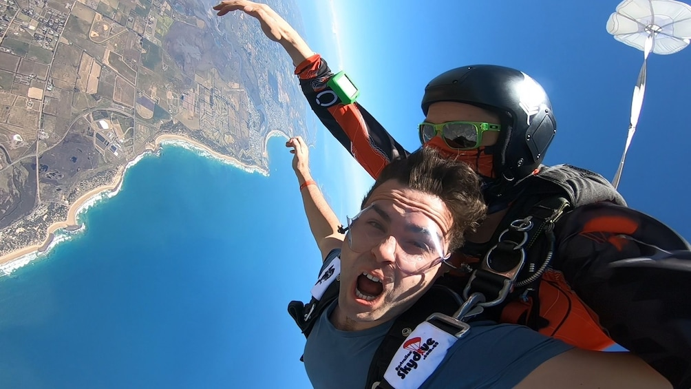 Show item 2 of 6. View of Bells Beach on a tandem skydive on a sunny day