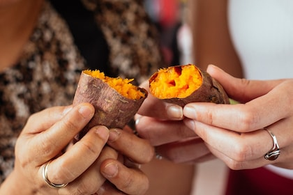 Women holding roasted sweet potatoes in Taipei