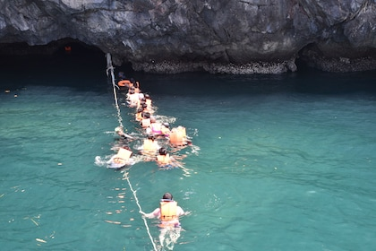 Group snorkeling at Emerald Cave on Koh Mook