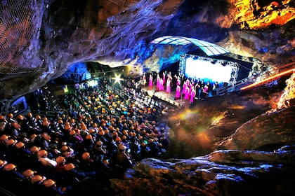 Audience watching performance inside Gwangmyeong Cave