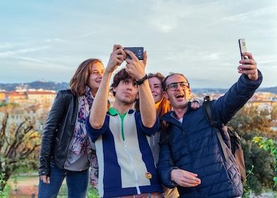 Group taking selfies in Florence