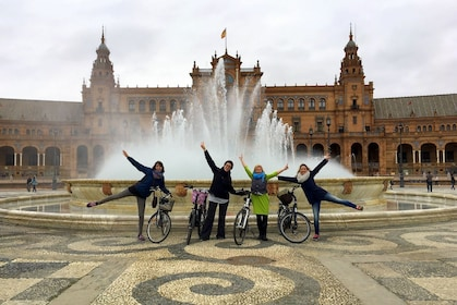 Group of bicyclists at a fountain in Seville