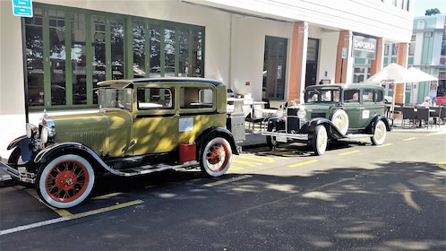 Two vintage cars parked on the streets in Napier
