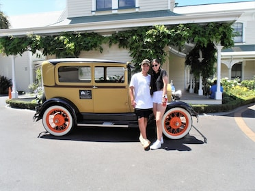 Couple standing in front of a vintage car in Napier