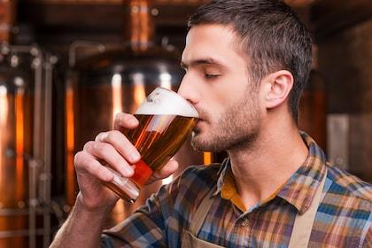 Man beer tasting at a brewery bar in Prague