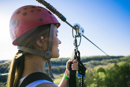 Woman getting ready to zipline on the Ozarks Explorer Zipline Canopy Tour