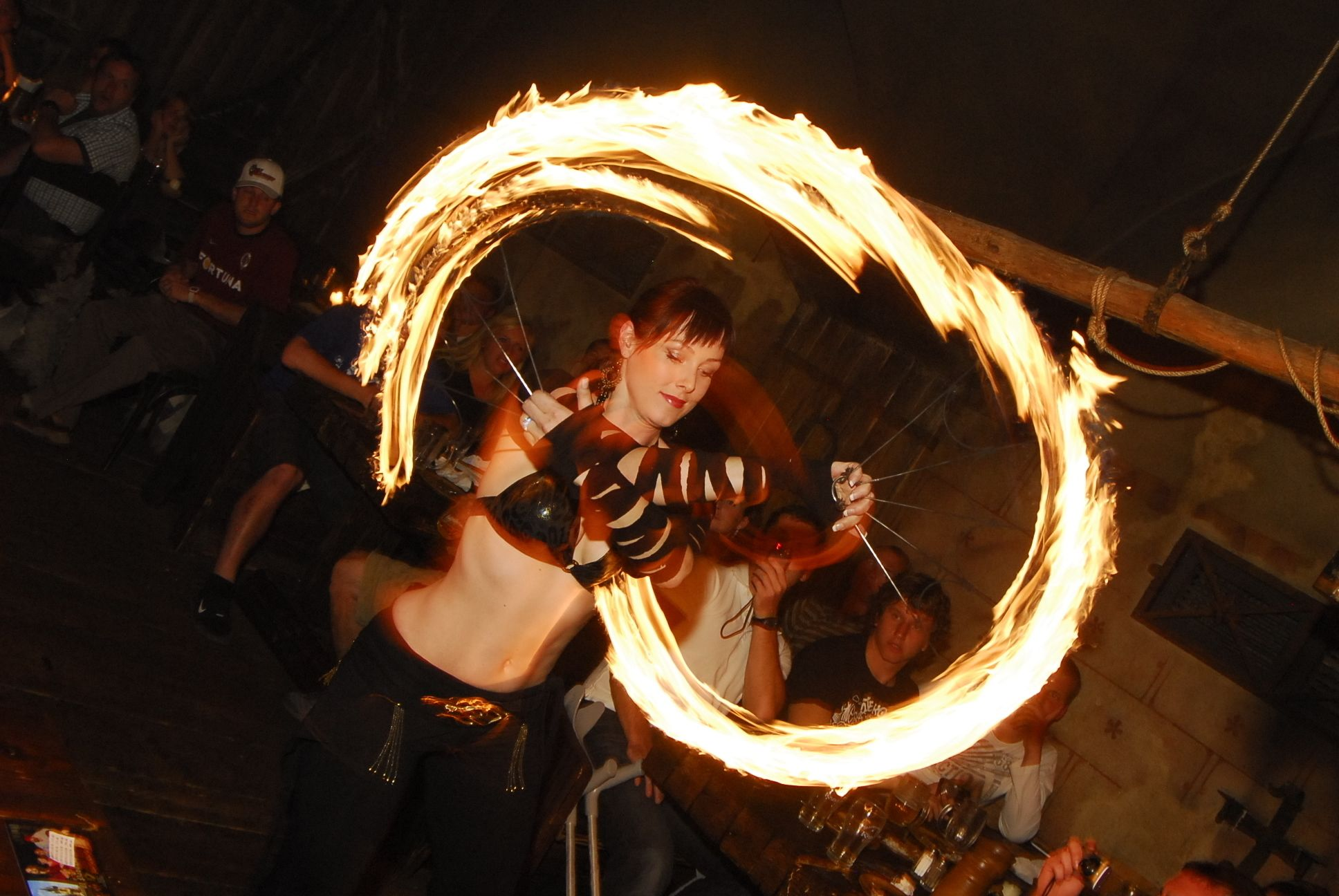 Woman performing with fire at the Medieval dinner in Prague
