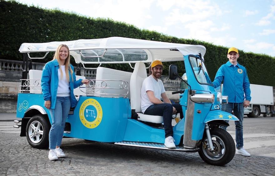 Group with tuktuk touring vehicle in Paris