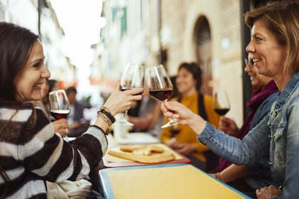 Woman toasting with red wine on a food tour in Florence