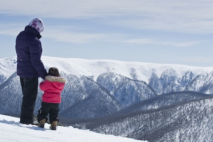 Mother and child walking in the snow in Mount Buller