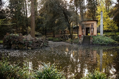 Pond and building with Egyptian statues in a park in Florence