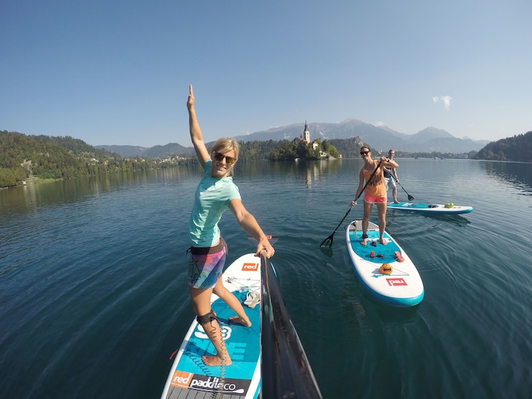 Show item 5 of 9. Group on a relaxing stand up paddle boarding adventure in Lake Bled, Slovenia