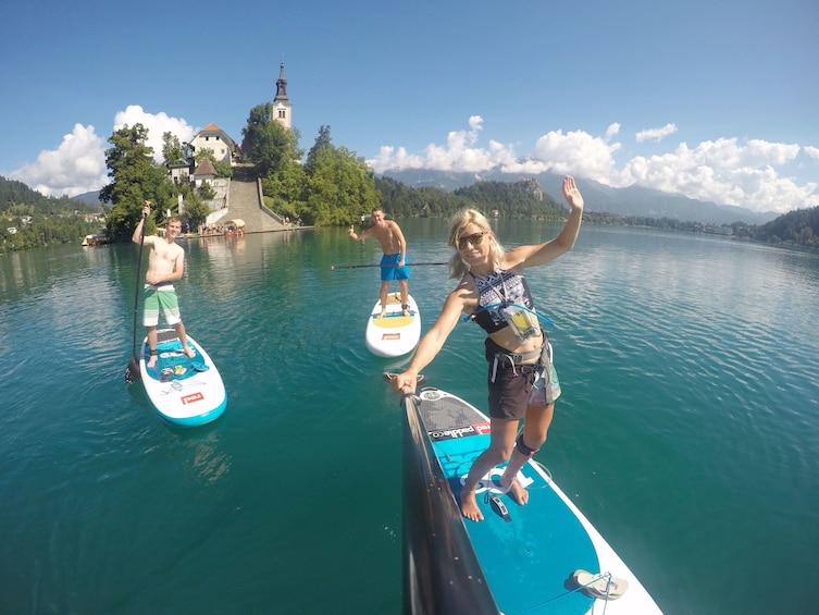 Show item 4 of 9. Group enjoying the refreshing stand up paddle boarding adventure in Lake Bled, Slovenia