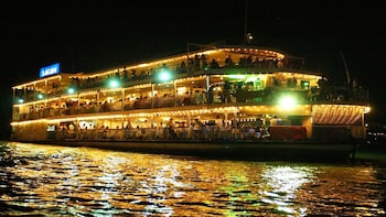 Saigon River Dinner Cruise, Cyclo Ride and Water Puppet Show