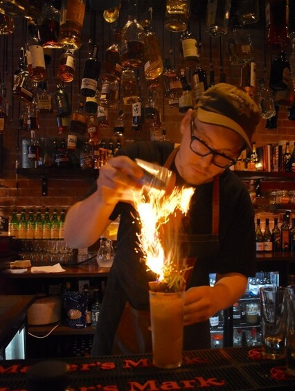 Show item 8 of 8. Bartender mixing drinks in Wellington