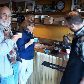 Couple enjoys coffee at a coffee roaster in Wellington